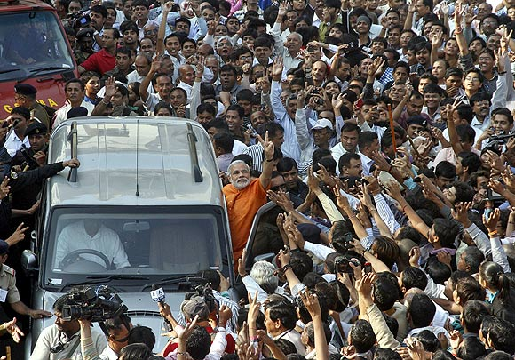 Gujarat Chief Minister Narendra Modi cheered on by his supporters