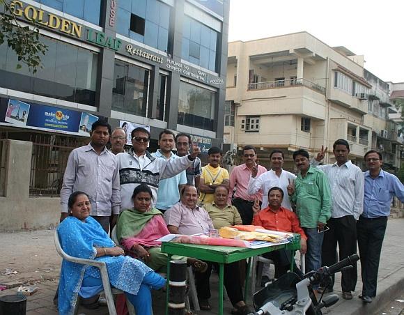 Tushar Parikh (in the green shirt), Tarak Gandhi (in the white kurta). Next to Parikh is Amod Pathak (in dark glasses)