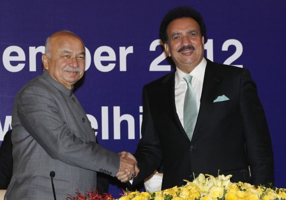Indian Home Minister Sushil Kumar Shinde with Pakistan's Interior Minister Rehman Malik before their bilateral meeting in New Delhi.