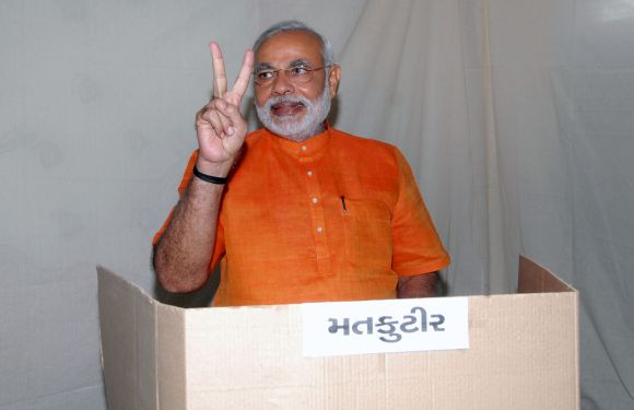 Modi casts his vote at a school in Ahmedabad's Ranip area on Monday