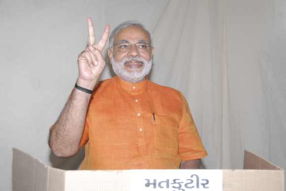 Modi casts his vote during the second phase of Gujarat elections in Ahmedabad