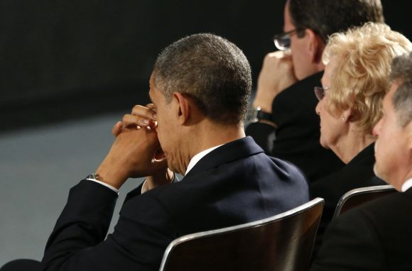 Barack Obama attends a vigil in Newtown, Connecticut for Sandy Hook Elementary School's shooting victims