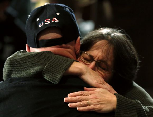 A woman hugs a man during a vigil for families of victims of the Sandy Hook Elementary School shooting in Newtown