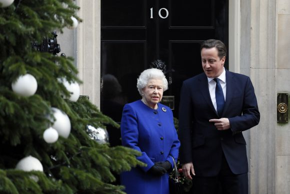 Britain's Queen Elizabeth is greeted by Prime Minister David Cameron as she arrives at Number 10 Downing Street in London