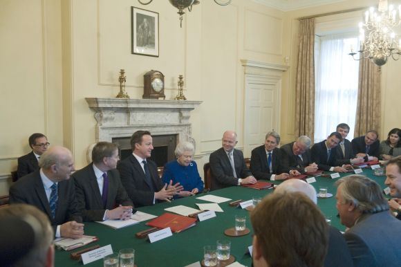 Queen Elizabeth listens during the cabinet meeting in Number 10 Downing Street in London