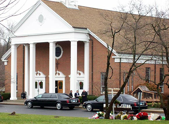 Mourners arrive for the funeral service at St Rose of Lima Church
