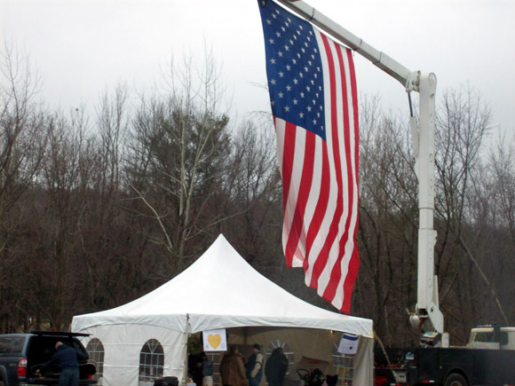 The American flag flies at half staff honouring victims of the school shootout in Newtown