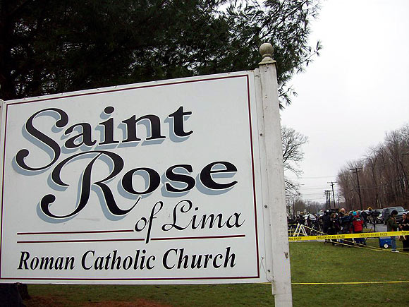 Media is gathered outside the St Rose of Lima Church