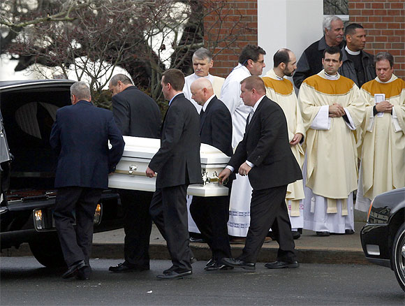 The casket of Jessica Rekos is carried from St Rose of Lima Church in Newtown, Connecticut