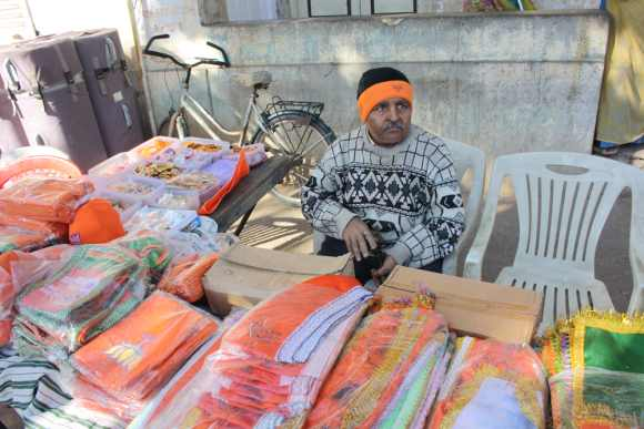 A vendor sells BJP flags and tee-shirts in Khanpur