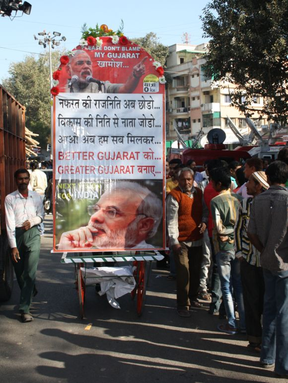 Posters lauding Narendra Modi outside BJP's Khanpur office in Ahmedabad