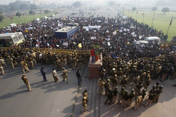 Police try to block demonstrators near the presidential palace during a protest rally in New Delhi.