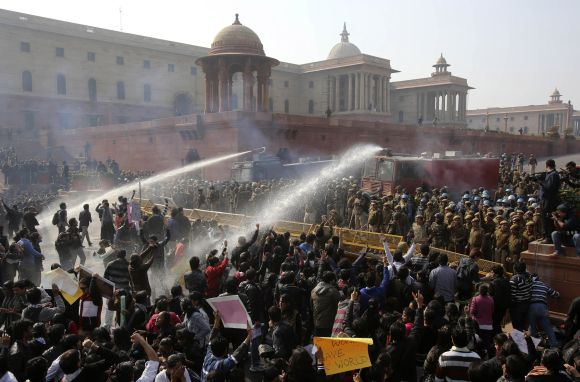 Police use water canons to disperse demonstrators near the presidential palace during a protest rally in New Delhi