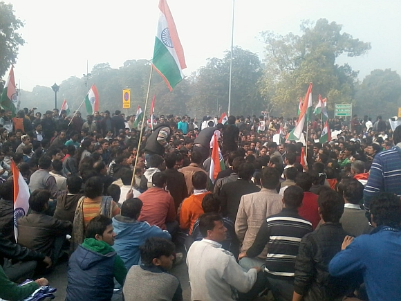 Protestors raise slogans at India Gate