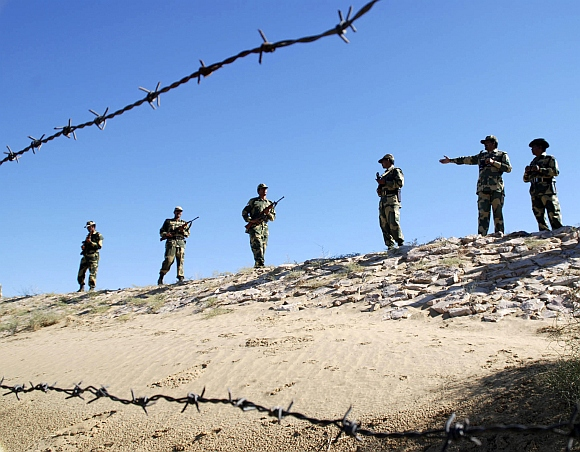 Border Security Force soldiers patrol the border at the India-Pakistan International Border Post, about 180 km from Bikaner