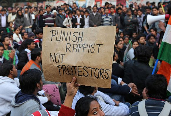 A demonstrator holds a placard during a protest in New Delhi