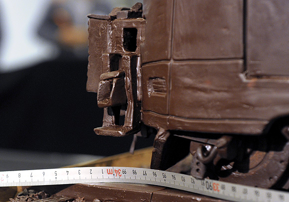 A tape measure shows the length of the world's longest chocolate structure on Guinness World Records, in Brussel