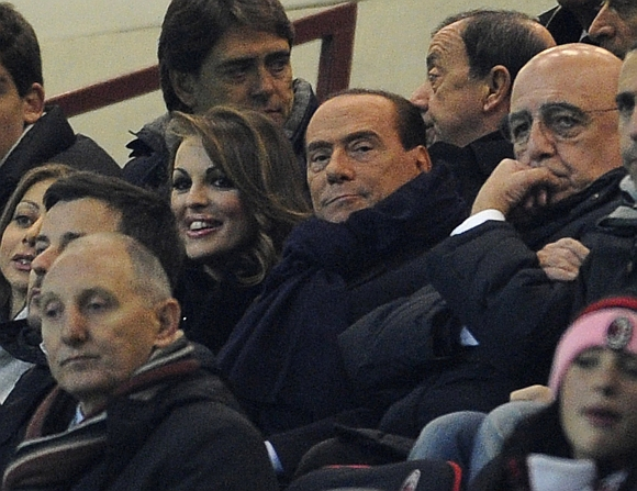 Silvio Berlusconi and Francesca Pascale attend a football match in Milan, Italy