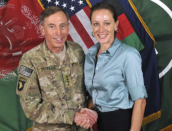 David Petraeus shakes hands with author Paula Broadwell
