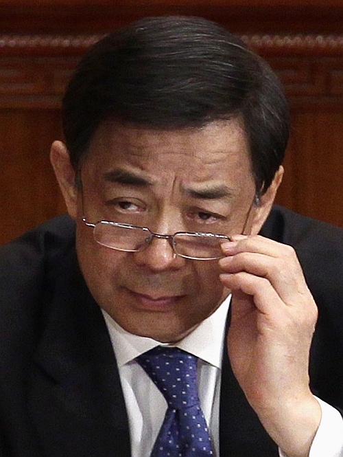 China's then Chongqing Municipality Communist Party Secretary Bo Xilai adjusts his glasses during the opening ceremony of the Chinese People's Political Consultative Conference at the Great Hall of the People