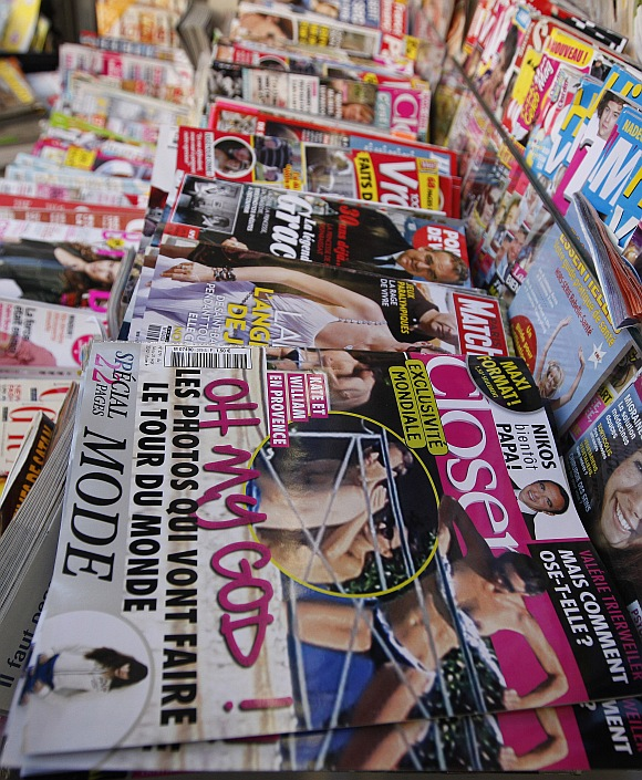 Copies of French magazine Closer showing pictures of Catherine, Duchess of Cambridge, and Britain's Prince William are displayed in a newspaper kiosk in Nice