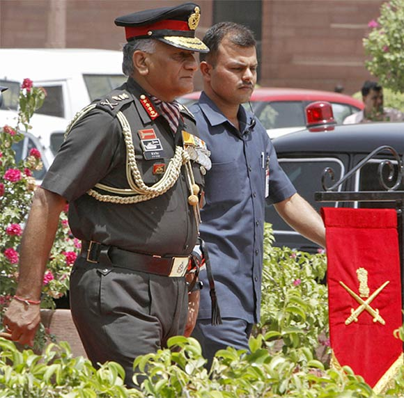Former Indian Army Chief General Vijay Kumar Singh walks to inspect his guard of honour outside the defence ministry building in New Delhi