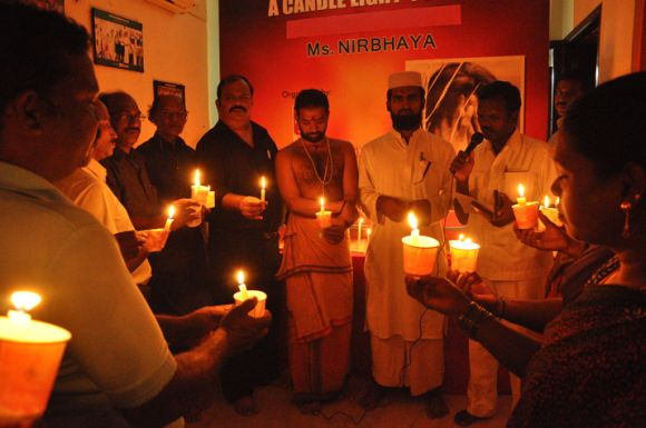 Members of the Indian Community Welfare Organisation hold a candle light prayer meeting in Chennai