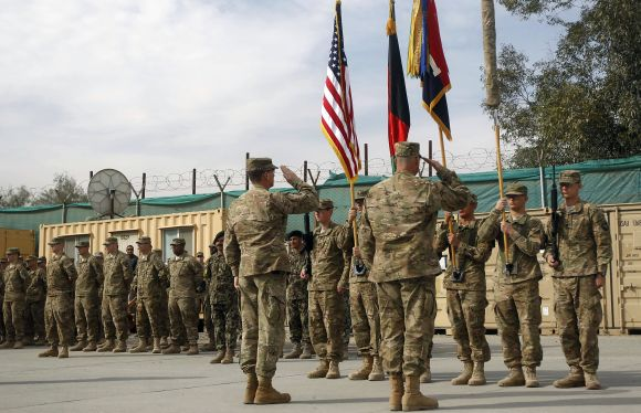 US troops with the NATO led-International Security Assistance Force attend a security transition from NATO troops to Afghan forces in Nangarhar, Afghanistan