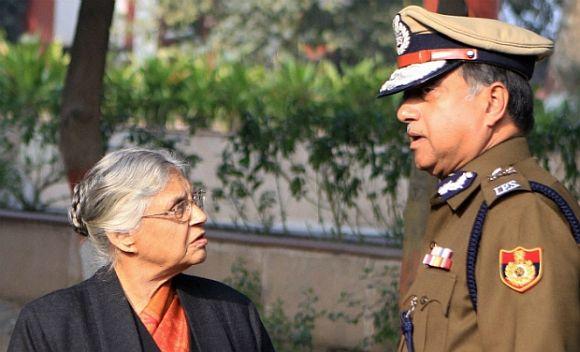 Delhi Police Commissioner Neeraj Kumar with Chief Minister Sheila Dikshit