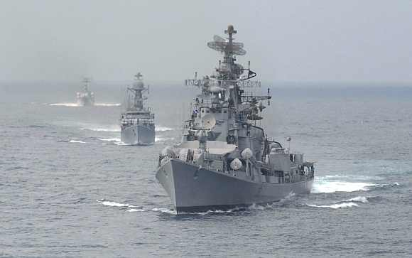 Indian naval warships form a line during an exercise in the waters of Bay of Bengal