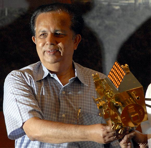 Former ISRO chairman G Madhavan Nair with a miniature of India's first unmanned moon mission 'Chandrayaan-1'
