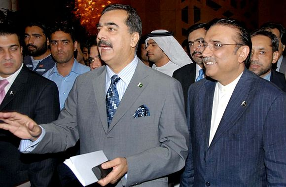File photo of Pakistan President Asif Zardari with Prime Minister Yousef Raza Gilani