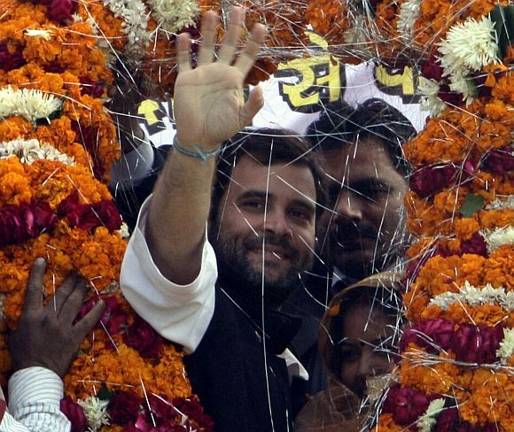 Rahul Gandhi greeted by Congress workers as he arrives to address a campaign rally in UP