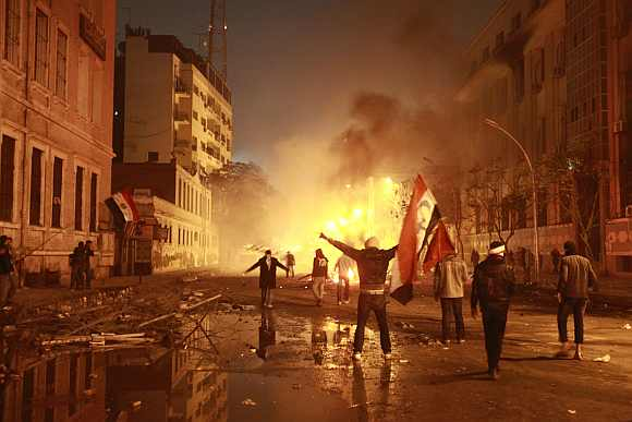 Protesters chant anti-government slogans during a protest condemning the death of soccer fans at Port Said stadium