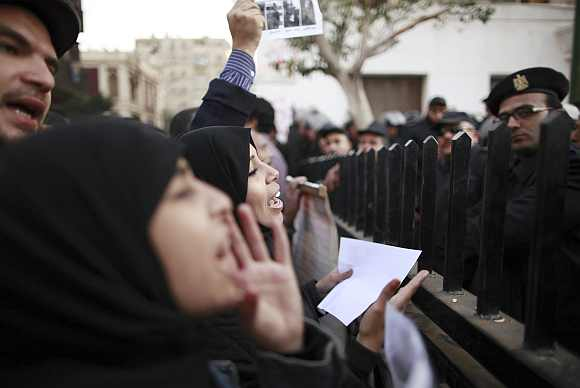 Demonstrators take part in a protest condemning the deaths that happened on Wednesday at Port Said stadium