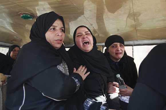 Relatives of victims killed in Port Said stadium cry as they wait to receive the bodies at a morgue in Cairo