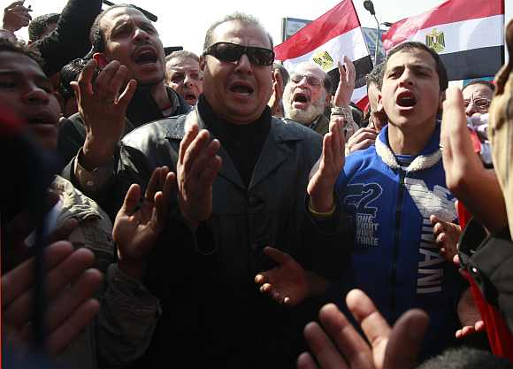 Supporters of al-Ahly soccer club pray for the souls of the victims killed in Port Said stadium during a protest in Cairo