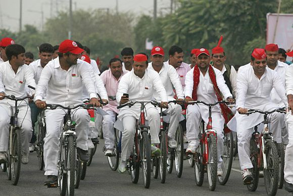 Mulayam Singh's son Akhilesh, centre, on a bicycle yatra with supporters