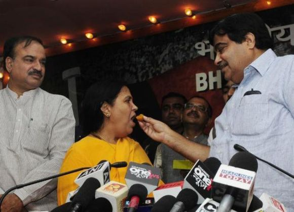 BJP President Nitin Gadkari, right, would not have bragged about bringing in Uma Bharti, centre, as a star campaigner had Bharti not been a Lodh
