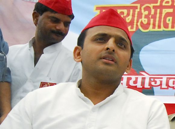 Thanks to the Congress going soft on Akhilesh Yadav, above, his wife Dimple and father Mulayam Singh have not been affected in the last five years