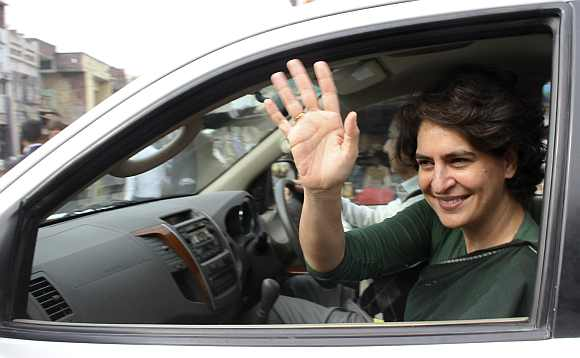 Priyanka Gandhi waves to supporters of the party after her address at an election campaign rally at Amethi
