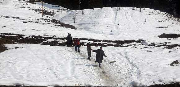 Children play in snow in Srinagar