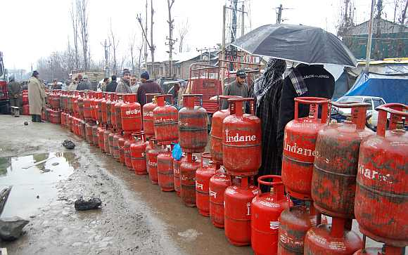 People wait for cylinders as rains lash parts of the Valley