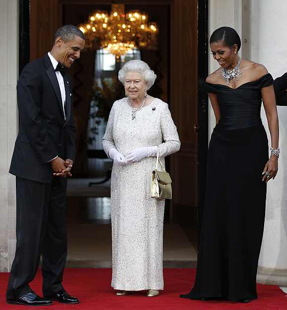 US President Barack Obama and first lady Michelle Obama welcome Britain's Queen Elizabeth to the Winfield House for dinner in London, May 25, 2011