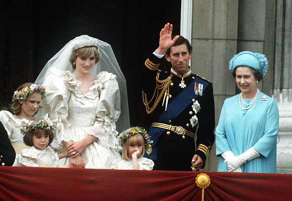 The Prince and Princess of Wales pose on the balcony of Buckingham Palace on their wedding day, with the Queen and some of the bridesmaids, 29th July 1981
