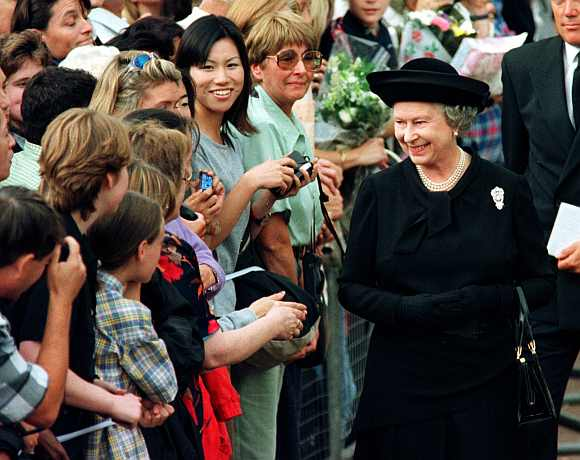 Queen Elizabeth II meets members of the public waiting in a queue to sign the book of condolence for Diana, Princess of Wales, outside St James's Palace, September 5 on 1997