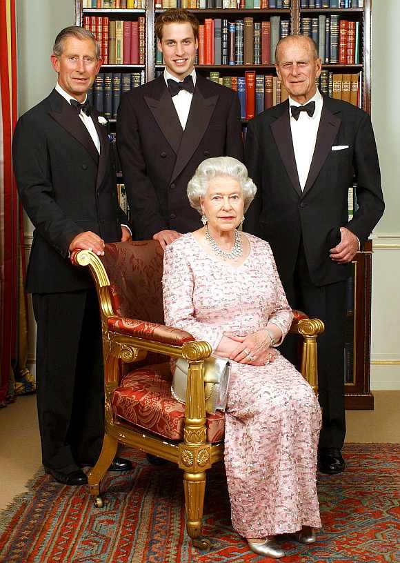 Three generations of Britain's Royal family, Queen Elizabeth II and her husband, the Duke of Edinburgh (right top ), their oldest son, the Prince of Wales (left top), and his oldest son, Prince William, pose for a photograph at Clarence House in London
