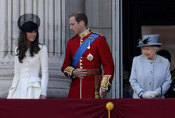 Britain's Queen Elizabeth, Prince William and his wife Catherine, Duchess of Cambridge  walk onto the balcony of Buckingham Palace after attending the Trooping the Colour ceremony in central London June 11, 2011. Trooping the Colour is a ceremony to honour the sovereign's official birthday