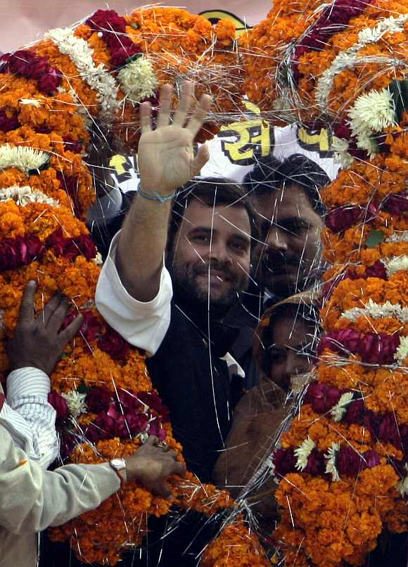 Rahul Gandhi waves to his supporters after receiving a garland from his party workers during an election campaign rally at Jari village, in the northern Indian state of Uttar Pradesh