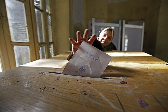 A woman casts her vote during the second round of parliamentary run-off elections at Shubra in El-Kalubia, on the outskirts of Cairo